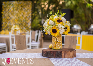 Stunning sunflower themed table centerpieces with fruits in vases