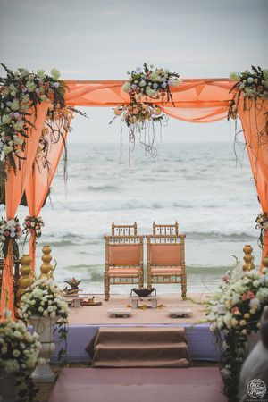 Simple peach mandap setting by the beach