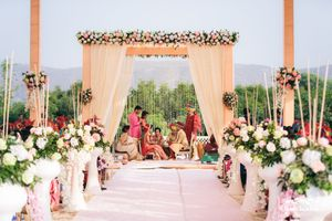 Beautiful mandap set up with floral against mountain scenery