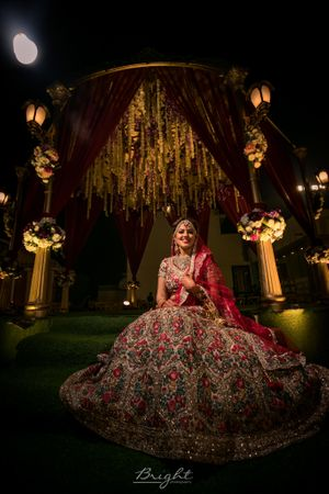 Offbeat bridal lehenga in red with floral embroidery
