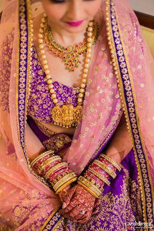Offbeat bridal lehenga with temple jewellery