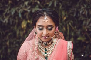 Layered bridal necklaces with emeralds and diamonds
