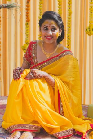 Beautiful yellow saree with red blouse and gold jewellery