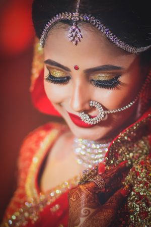 Beautiful bridal makeup with gold shimmer eye makeup