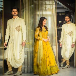 Unique groomswear and heavy yellow anarkali