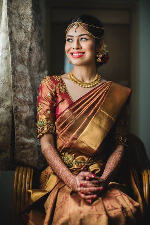 South Indian bride with gold and red kanjeevaram and traditional jewellery