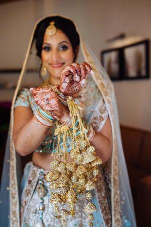 A bride in blue flaunts her kaleere