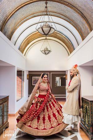 Beautiful bridal shot in red and gold lehenga
