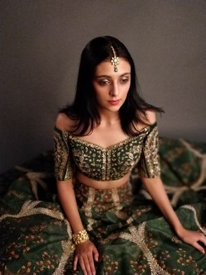 Off shoulder forest green lehenga for the sister of the bride or groom
