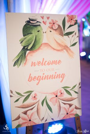 Cute welcome sign with birds and florals