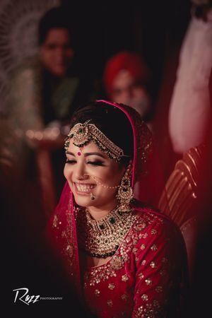 Pretty laughing bridal portrait on wedding day