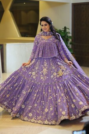 Pretty lavendar lehenga with floral motifs and long top