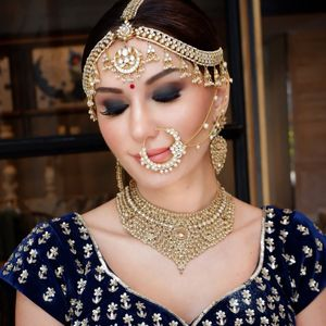 Gorgeous gold bridal jewellery with royal blue blouse