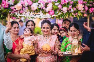 South Indian bride entering under phoolon ka chadar