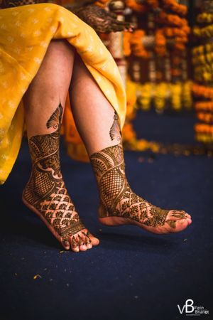 A bride with mehendi on her feet