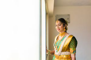South Indian bride with gold and green saree