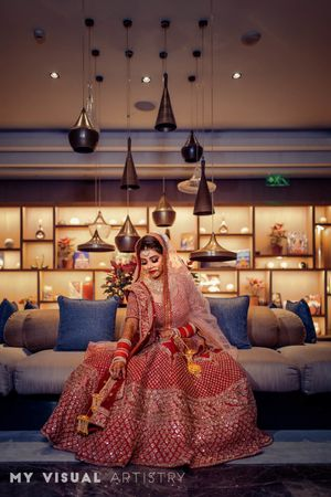 A bride in red lehenga