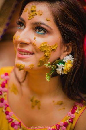 Floral earring on bride for haldi
