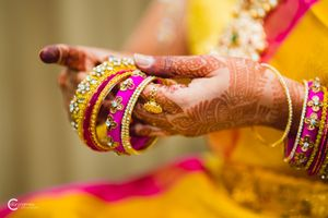 Matching zardozi bangles for South Indian bride