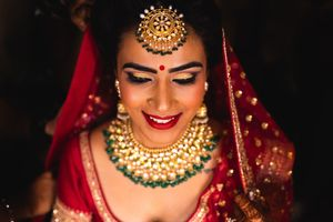 A bride ready for her wedding sits pretty