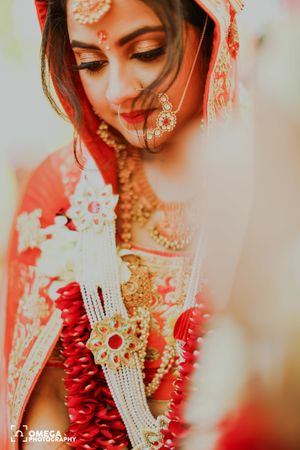 A bride in orange lehenga