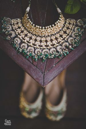 Dark green jewellery photography with shoes