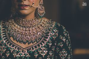 Heavy bridal bib necklace with green beads
