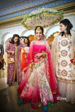 Bright pink mehendi lehenga bridal entry shot