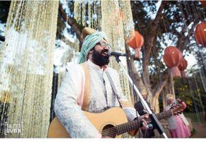 Unique idea as groom sings for bridal entry
