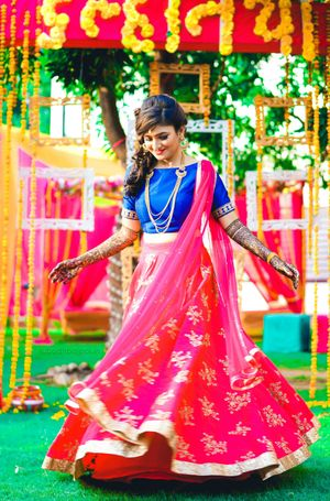 Contrasting blouse and lehenga for mehendi in red and blue