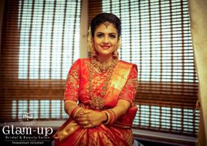 A south indian bride in red kanjeevaram saree and temple jewellery