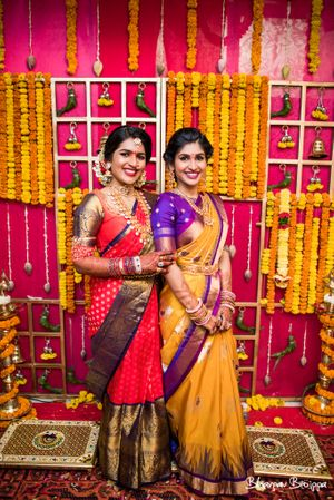 South Indian bride with sister in saree