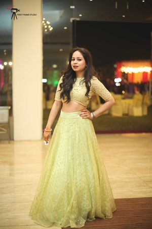 A bridesmaid in a light green lehenga