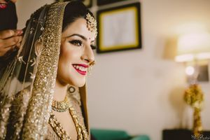 Bridal portrait in gold with red makeup