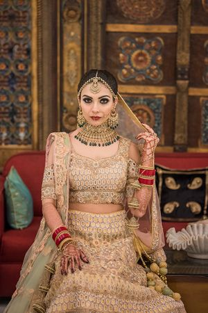 Beige lehenga with cold shoulder blouse