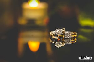 His and her engagement rings with reflection