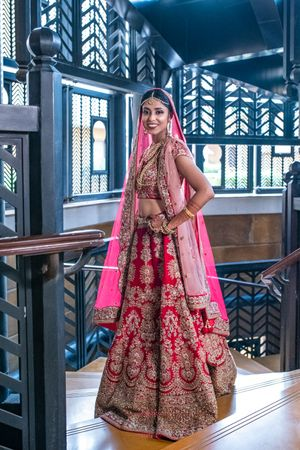 A bride in red lehenga with double dupatta