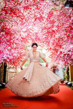 Twirling bride in silver engagement lehenga