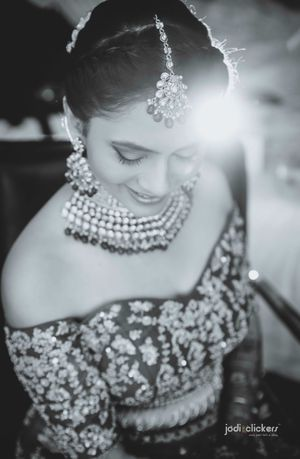 Black and white bridal portrait with off shoulder blouse