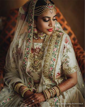 Bride in white lehenga and exquisite jewellery