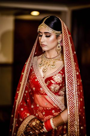 Red Sabyasachi bridal lehenga with florals