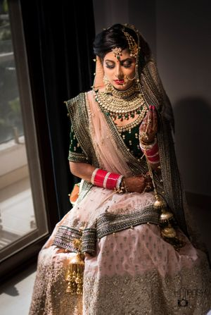Bride in light pink lehenga