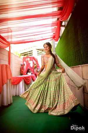 Happy bride shot in green mehendi lehenga