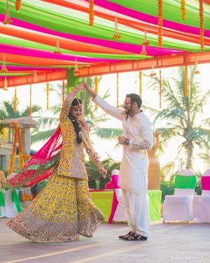Bride and groom on mehendi day