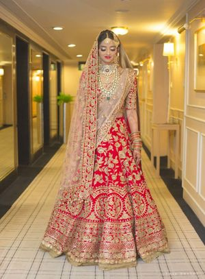 A bride in red lehenga and double dupatta
