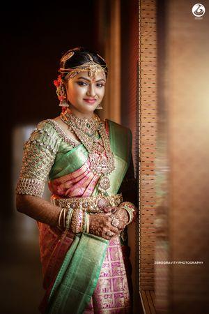 Gorgeous south Indian bride wearing kanjivaram saree with jewels