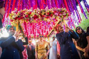 South indian bride enters under a phoolon ki chadar