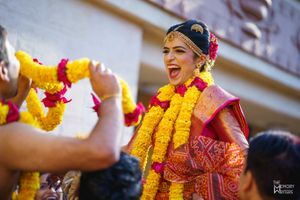 A south indian bride laughs her heart out during her wedding