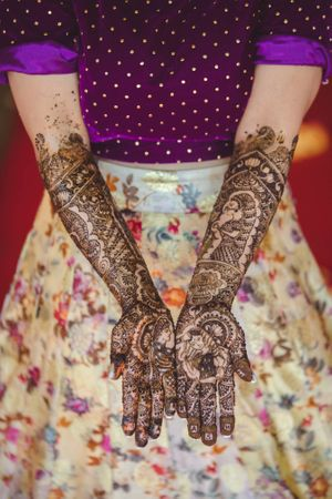 Unique bridal half and half mehendi design with Pooja