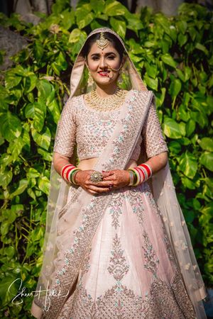 Blush pink bridal lehenga with blue work